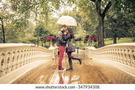 Lovely couple in Central park, New york under the rain