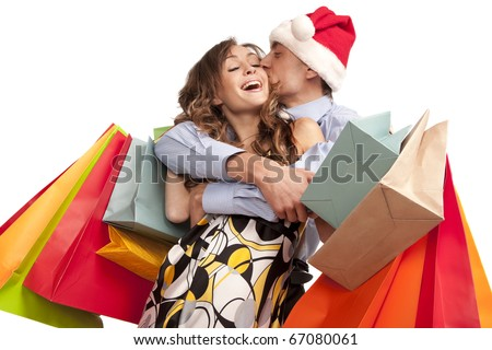 Lovely couple making christmas shopping. Isolated on white.