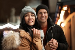 Lovely couple on city street. Winter vacation