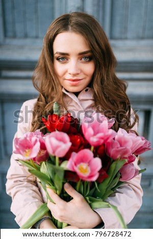 https://image.shutterstock.com/display_pic_with_logo/4116337/796728472/stock-photo-lovely-cute-amazing-brunette-girl-standing-in-front-of-old-vintage-blue-door-with-a-bouquet-of-796728472.jpg