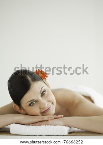 Lovely dark-haired woman getting a spa treatment lying down