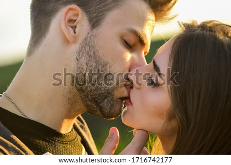 Lovely date. kissing couple portrait. delicate gorgeous kiss. man kiss woman. couple in love. I love you. Closeup mouths kissing. romantic relations. married couple kissing making love on honeymoon.