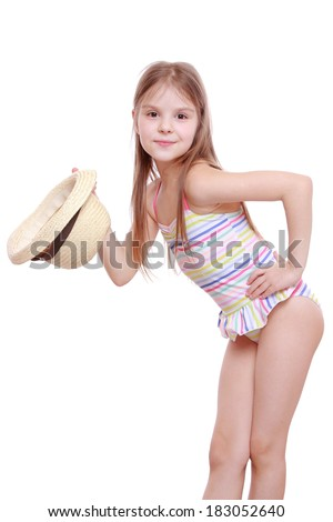 41b62bc452e94 Lovely emotional little girl in modern swimsuit and straw hat isolated over  white background/Fashion