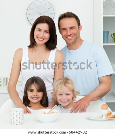 Lovely family during breakfast in the kitchen at home