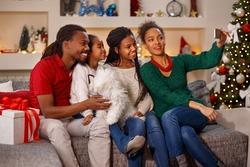 lovely family making selfie on Christmas