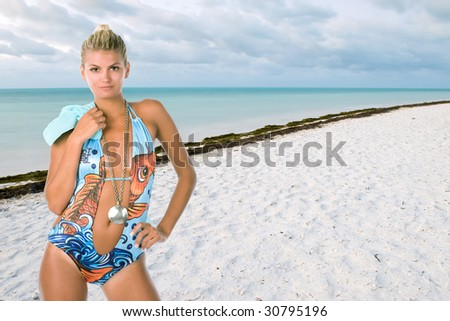 lovely female model in swimsuit illustrated on florida keys beach on cloudy day