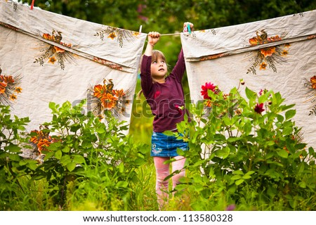 Lovely five-year girl with clothespin outdoor