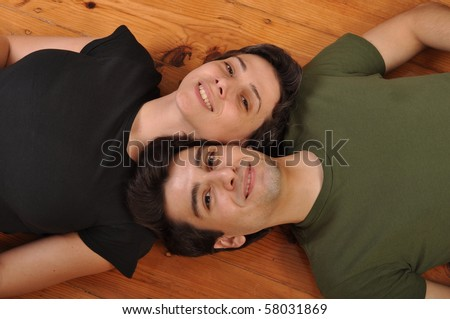 lovely friendship between sister and brother lying and relaxing on the floor