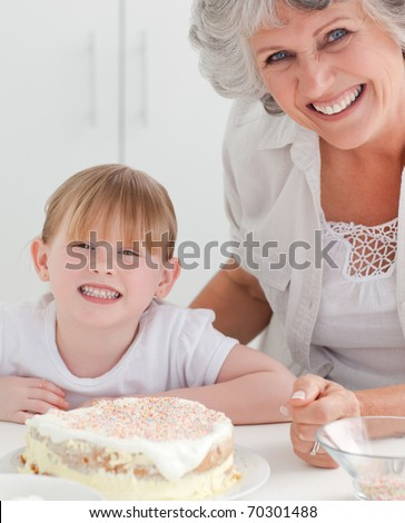 Lovely girl and her grandmother looking at the camera