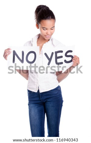 Lovely girl holding yes and no word board over white background