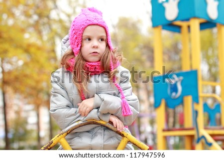 Lovely girl playing in the park - stock photo