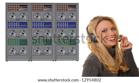 Lovely girl wearing a headset in front of a mainframe computer - stock photo