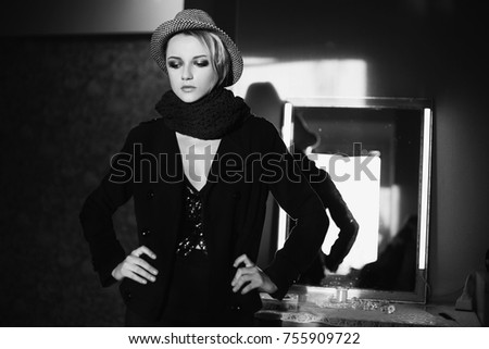 Stock Photo Lovely girl with tanned skin and white hair in a hat and black jacket. Female beauty portrait of a beautiful makeup. Female street fashion style. Natural light