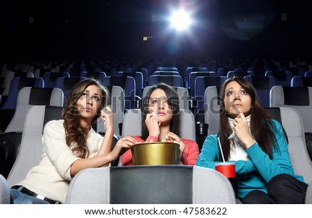 Lovely girls cry at viewing at cinema
