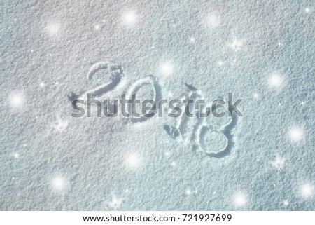Lovely happy new year 2018 celebration greeting card decoration background. Message handwritten on the fresh snow. #721927699