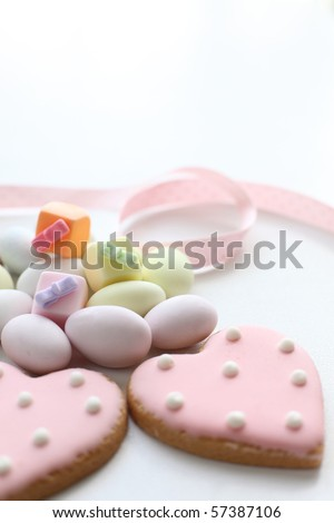 Lovely heart icing cookies and candies - stock photo