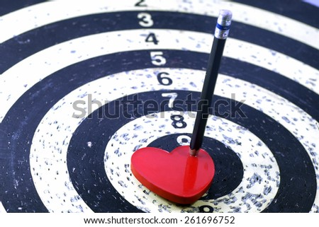 Lovely heart pencil target to the dart for lover or business concept #261696752