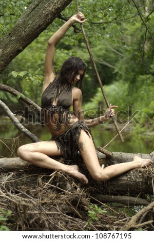 Lovely lady posing with a loincloth on the nature