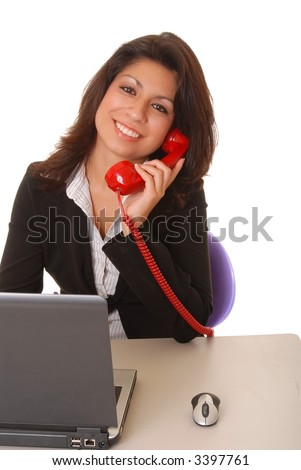 Lovely latina business woman hard at work - stock photo
