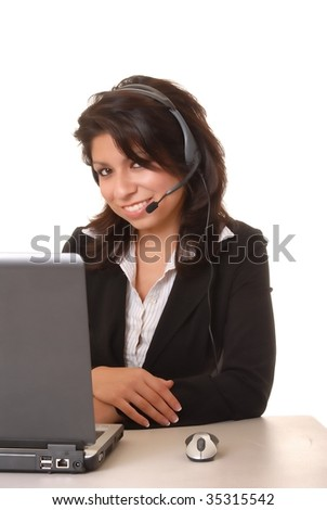 Lovely latina businesswoman hard at work on computer