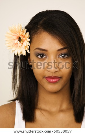 Lovely Latina or Hispanic look with flower in hair