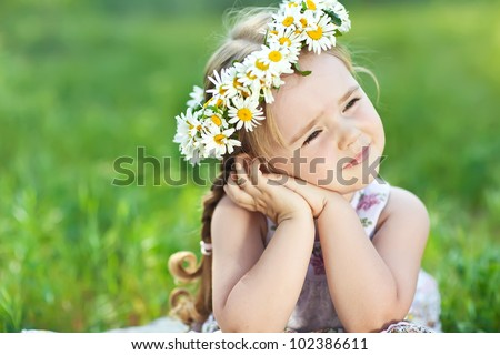 Lovely little baby girl with daisy wreath on her head