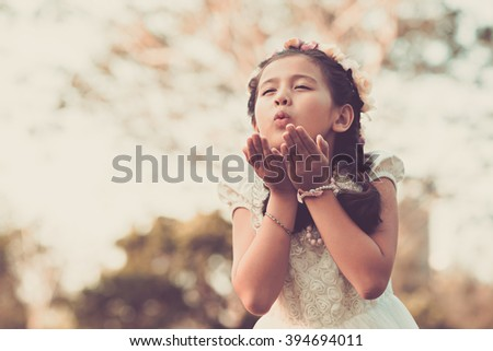 Stock Photo Lovely little girl blowing a kiss to somebody
