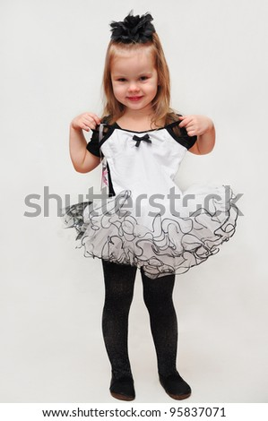 Lovely little girl, dressed as a ballerina wearing another leotard, isolated on white background