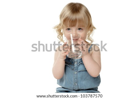 Lovely little girl drinking water, over white