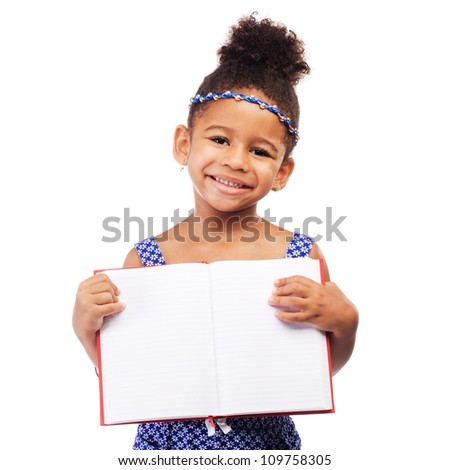 Lovely little girl holding an open notebook
