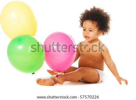 Lovely little girl with colorful balloons sitting on white