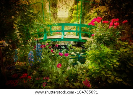 Lovely Monet type garden and bridge with artistic texture effect.