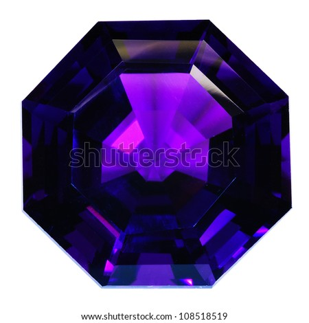Lovely natural dark violet amethyst with an octagon shape. Isolated on white. Wonderful facets.