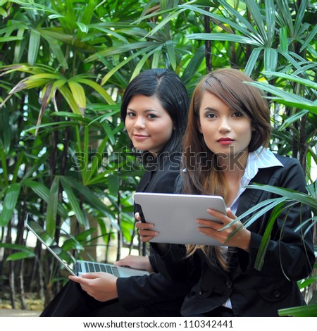 Lovely of young Asian businesswoman take rest with laptop while office break