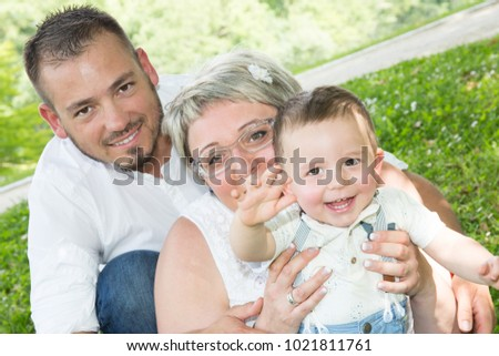 Lovely outdoor portrait of caucasian family #1021811761