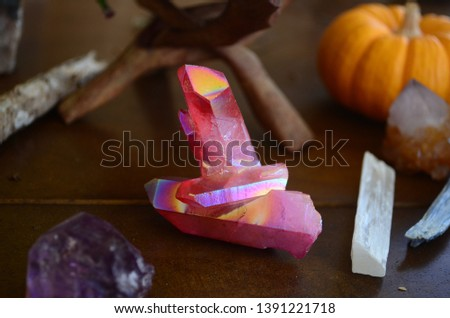 Lovely pink aura quartz, flame aura. Healing crystal pink quartz. Bright iridescent picture of crystal in natural lighting, with macro lens. Sparkling quartz crystal.