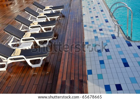 lovely pool deck and chaise lounges on luxury cruise ship