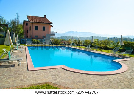 Lovely pool in the garden in the park. swimming pool and a small hotel