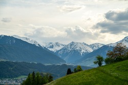 Lovely sea of snowcapped mountains with beautiful greenery