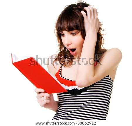 Lovely shocked brunette with a red book on white background