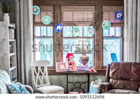 Lovely Sitting Room in Craftsman style home decorated for Baby Shower, with chairs and antique sewing table in front of window #1093112696