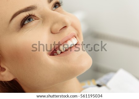 Lovely smile of pretty woman at stomatological clinic