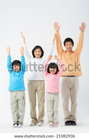 Lovely Smiling Family - raising hands for cheers