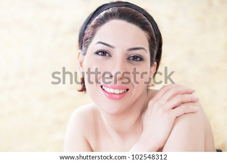Lovely smiling woman relaxing in day spa