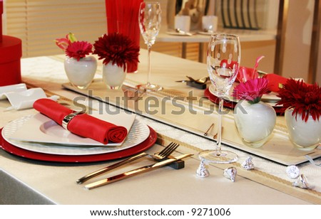 Lovely table setting for two in red