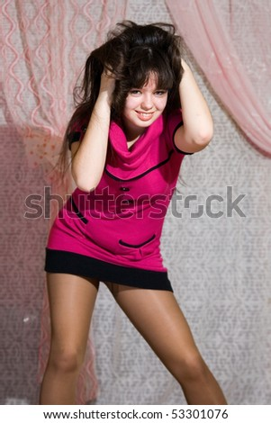 stock photo : Lovely teen girl in pink dress