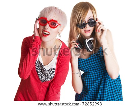 Lovely teenage girls having fun together, white background