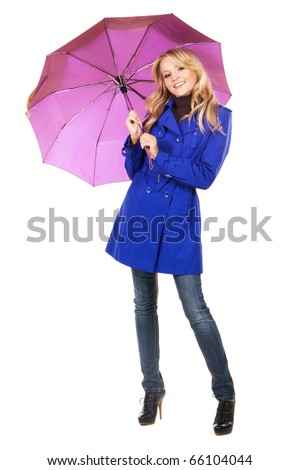 Lovely woman in a blue coat with umbrella against white background