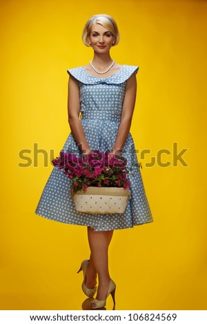 Lovely woman in a blue dress with a flowers