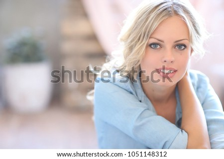Lovely woman in blue shirt #1051148312